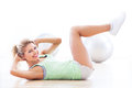 Woman doing sit ups working out at a health club Royalty Free Stock Photography