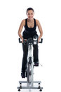 Woman doing spinning bike smiling training on exercise Stock Images