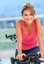 Woman doing spinning in a gym Royalty Free Stock Photos