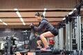 Woman Doing Squats On Platform...