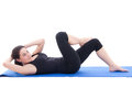 Woman doing strength exercises for abdominal muscles isolated on young white background Royalty Free Stock Photography