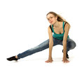 Woman doing stretching exercise on white background Stock Photo