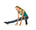 Woman doing stretching exercise on white background Royalty Free Stock Images