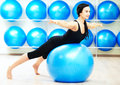 Woman doing stretching on fitness ball young during pilates exercises in sport club Stock Photography