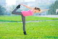 Woman doing stretching fitness exercise. Yoga postures Royalty Free Stock Photo