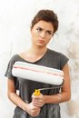 Woman doing wall painting disgruntled young brunette Stock Image