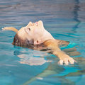 Woman doing water yoga for relaxation young in a swimming pool Royalty Free Stock Images