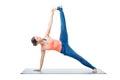 Woman doing yoga asana Vasisthasana variation