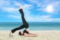 Woman doing yoga exercise on the beach Royalty Free Stock Photo