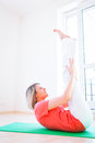 Woman doing YOGA exercise at home Stock Photography