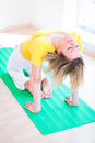 Woman doing YOGA exercise at home Stock Photos