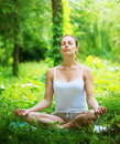 Woman doing yoga exercise young outdoor Royalty Free Stock Photos
