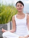 Woman doing yoga and meditating with eyes closed Royalty Free Stock Photo