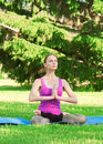 Woman doing yoga meditation Royalty Free Stock Image