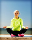 Woman doing yoga outdoors sport and lifestyle concept Stock Image