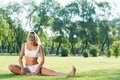 Woman doing yoga in the park young attractive active lifestyle Stock Photo