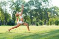 Woman doing yoga in the park young attractive active lifestyle Royalty Free Stock Photo