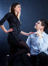 Woman dominating scene of a elegant women her husband Stock Photography