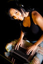 Woman downloading to music Stock Photos