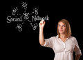 Woman draving social network theme on whiteboard young Royalty Free Stock Photo