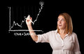 Woman drawing graph on whiteboard young Royalty Free Stock Photo