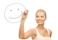 Woman drawing happy face Royalty Free Stock Photos
