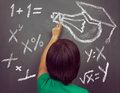 Woman is drawing lightbulb unrecognizable and formulas on the blackboard concept of education Stock Images