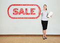 Woman drawing sale businesswoman in office symbol Stock Image