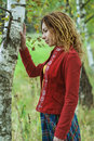 Woman with dreadlocks near birch young beautiful in red clothes Stock Image