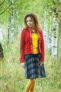 Woman with dreadlocks near birch young smiling beautiful in red clothes Stock Image