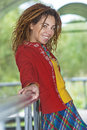 Woman with dreadlocks near wooden railing young smiling beautiful in red clothes Royalty Free Stock Photos