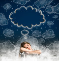 Woman dreaming with cloud over her head Royalty Free Stock Photo