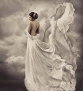 Woman dress artistic white blowing gown waving a and fluttering fabric fantasy wedding bride cloth Stock Photos