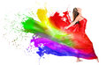 Woman dress turning into color paint happy isolated over white Stock Photo