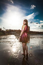 Woman in dress walking barefoot on embankment beautiful young Royalty Free Stock Photography