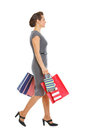Woman in dress walking with shopping bags Stock Image