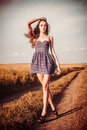 Woman in dress walking on the trail atl field beautiful girl Royalty Free Stock Photography
