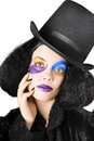 Woman dressed as jester young with top hat face makeup and long black hair costume Stock Images