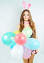 Woman dressed as rabbit holds balloons Stock Images