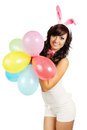Woman dressed as rabbit holds balloons Royalty Free Stock Photography