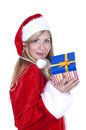 Woman dressed as Santa and holding a present Stock Photo