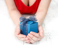 Woman dressed in red offering a special present Stock Photo