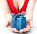 Woman dressed in red offering a special present Royalty Free Stock Photo