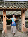 A woman dressed in traditional chinese costume standing front of the ancient zhaimen Royalty Free Stock Photos