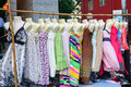Woman dresses hanging on display at a flea market