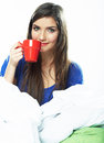 Woman drink coffee in bed close up female face portrait Royalty Free Stock Image
