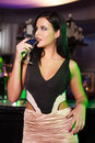 Woman drink martini in bar sensual brunette Stock Photos