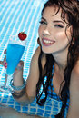 Woman with drink  in  pool Royalty Free Stock Images