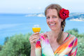 Woman with drink and red rose near sea caucasian in greece Royalty Free Stock Photo