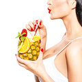 Woman drink tropical cocktail in pineapple with straw closeup Royalty Free Stock Photo